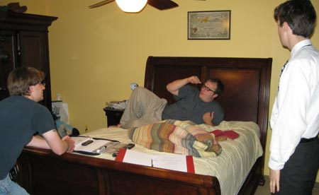 In the home of Marty Moore, also known as Rob Flannigans bedroom.  R-L: production assistant Gary Carper, director John Johnson, actor Mikiah Umbertis.  We couldnt use any copyright-protected artwork to dress the set, so over the bed hangs my grandfathers U.S. Navy pollywog certificate for crossing the Equator in 1929.