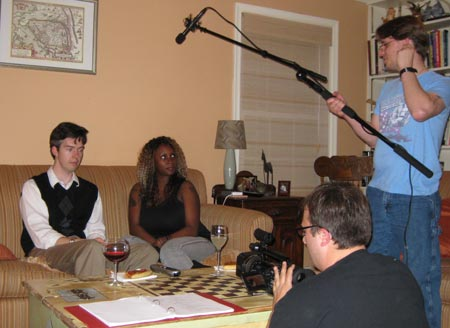 L-R: Mikiah Umbertis (Rob), Monique Dupree (Jennifer), director John Johnson, and production assistant Gary Carper.  Everything about Rob and Jennifer are the exact opposite of each other: their time travel abilities, their genders and ethnicities, even their choice of wine.
