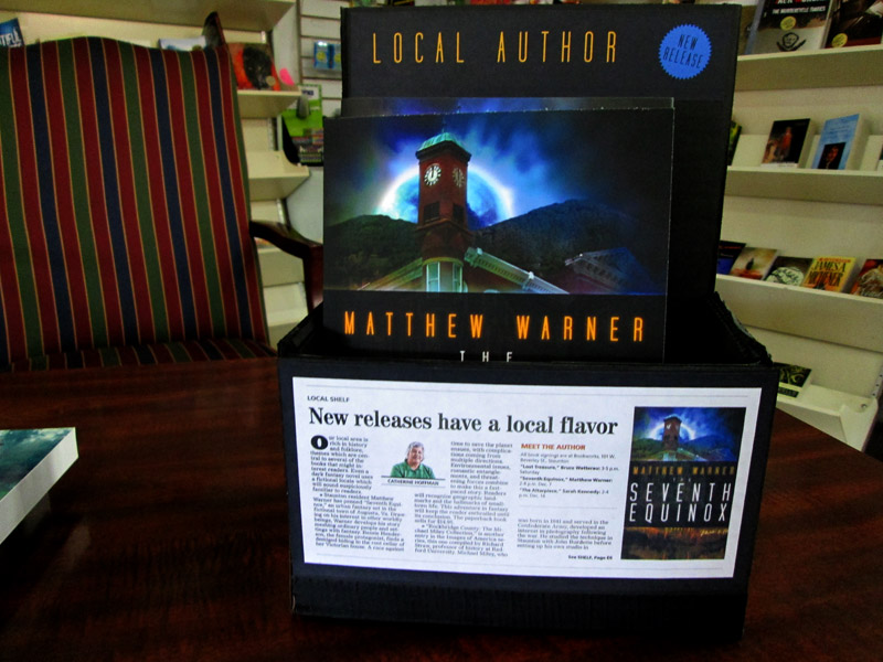 Point-of-purchase display for THE SEVENTH EQUINOX, made by my awesome wife (and featuring her cover art). The article on the front ran in the Nov. 10, 2013 edition of the News Leader.