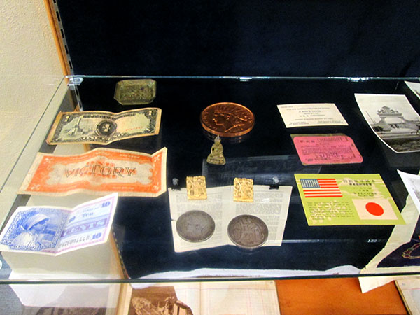 "Samples of currency and souvenirs from sightseeing junkets. On the left are examples of ""Victory Pesos"" in Japan and the Phillipines; these were temporary forms of currency issued by the U.S. government."