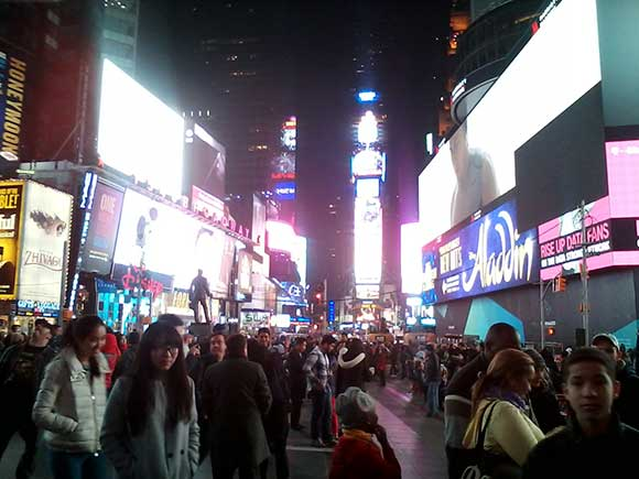 Pande . . . wait for it . . . monium. That's right, this is Times Square, and you better have your wallet in your front pocket.