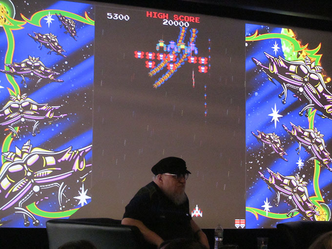 GRRM dismissed us by rows so we could get in line for the Ernest Cline book signing. As we waited, audience members played 80s video games like Galaga on the screen behind him. I didn't play myself, figuring I'd be too nervous to play with GRRM directly in front of me.