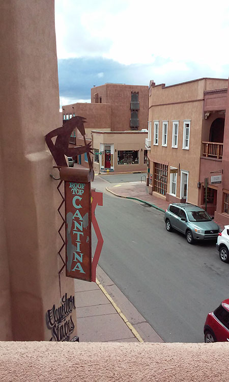 Street view of Santa Fe, NM, where all the buildings look like chocolate cake by law.