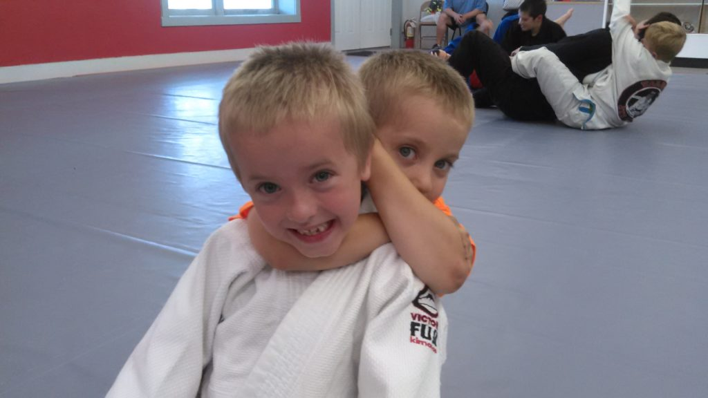 This week, my youngest son Thomas (5) had his first lesson in Brazilian jiu-jitsu. Here he is applying a rear-naked choke to his brother Owen.